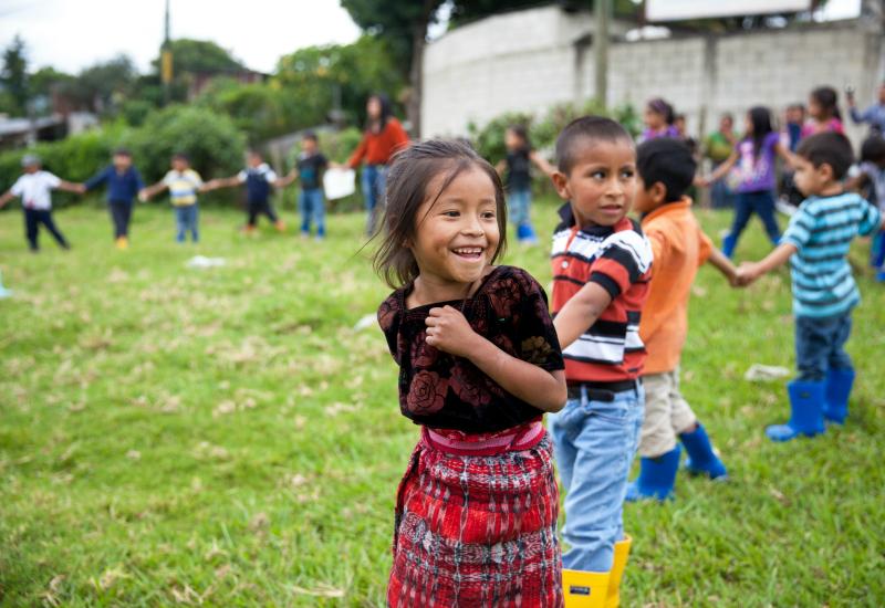 Guatemalan children play in their brand-new Roma