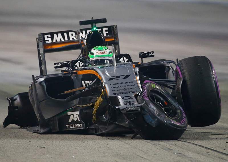 Force India's Nico Hulkenberg reacts after crashing during the race.