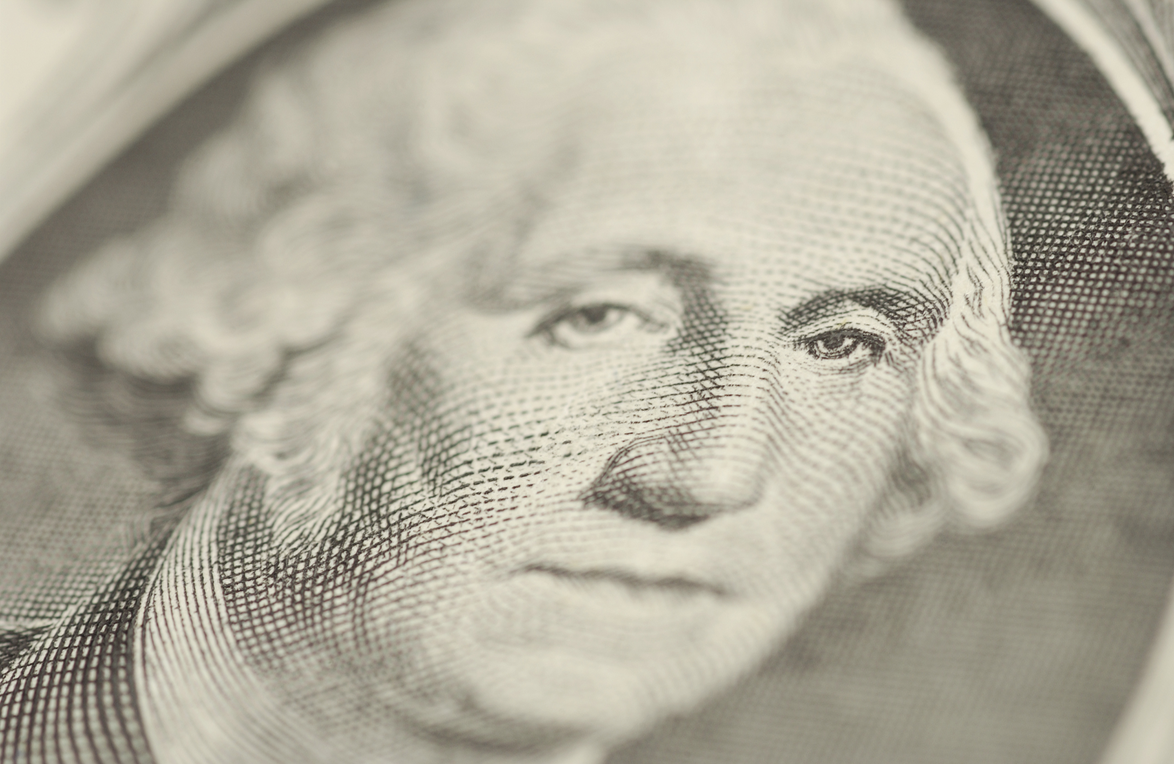 Close-up of George Washington on one dollar bill