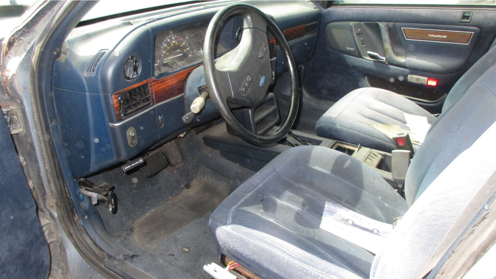 The blue velour upholstery looks good, indicating that the car was well  cared for during its time on the road.
