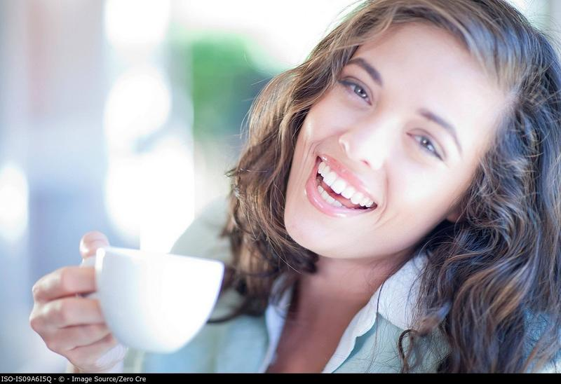 Woman having cup of