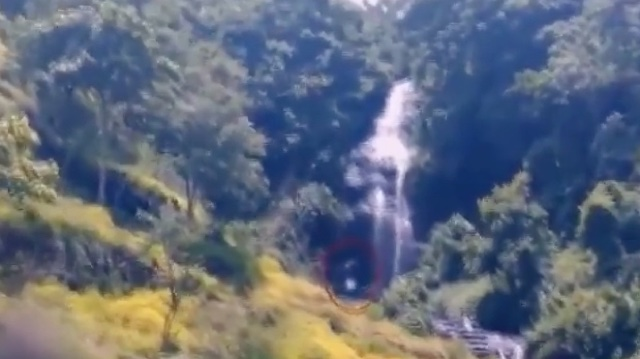 Is that 'BigFoot' walking though waterfall in Indonesia?