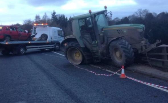 Tractor teeters over 140ft bridge after A5 crash