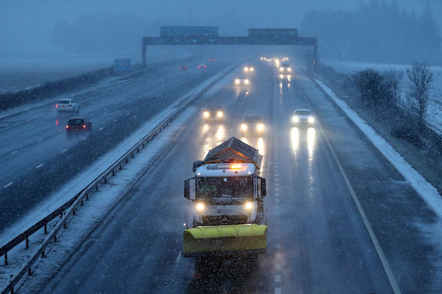 A gritter makes its way along the M9 near Falkirk during a snow blizzard in Central Scotland.