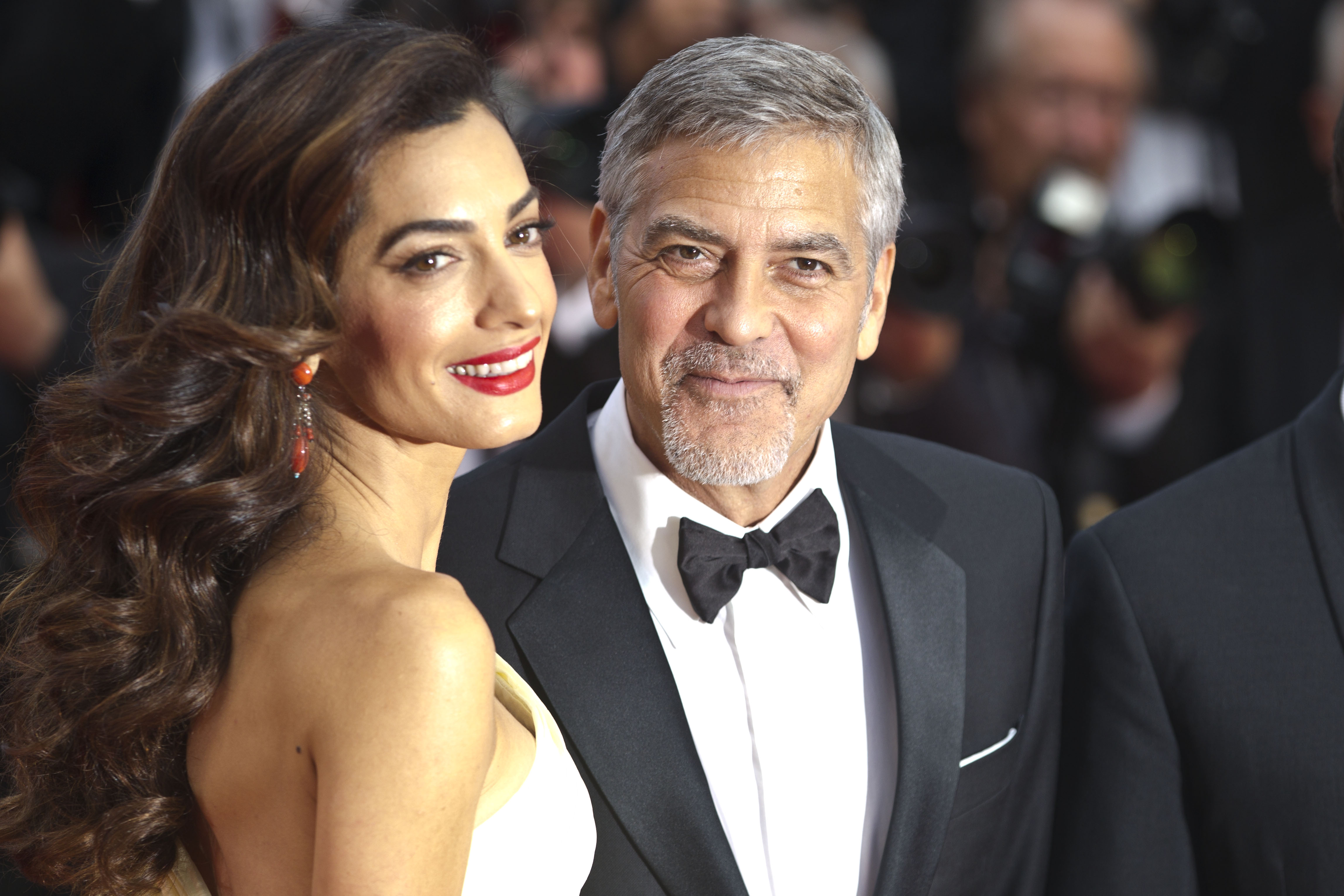 Amal Clooney and George Clooney attend the screening of '