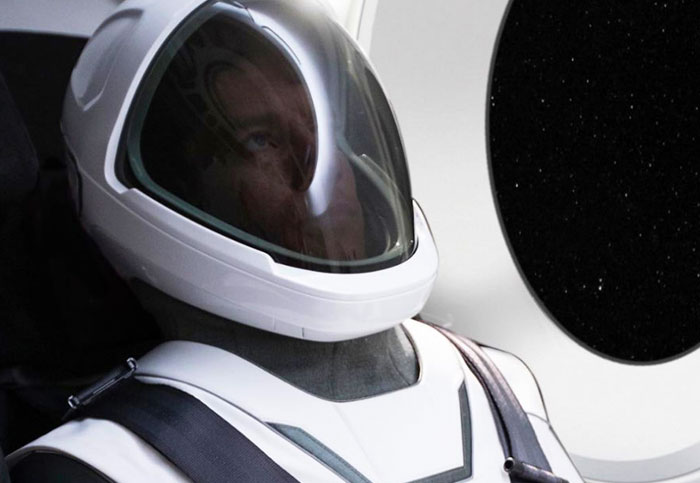 Elon Musk shows off SpaceX's custom spacesuit