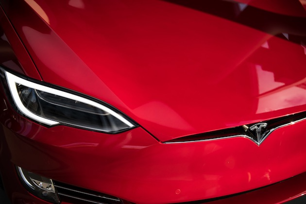FILE: The headlight of a Tesla Inc. Model S P100D sedan vehicle is seen at the company's new showroom in New York, U.S., on Thursday, Dec. 14, 2017. For BMW AG, Tesla Inc. and other global automakers whose future is ever-more dependent on China's burgeoning market, any gains from lower import tariffs this week will likely be short-lived -- thanks to President Donald Trump's trade war. Unless President Trump backs down, on July 6 the U.S. will impose tariffs on $34 billion of Chinese imports, many of them parts used in products such as marine engines and power turbines. China will impose countervailing levies the same day -- including on U.S.-manufactured cars. Our editors select archive images of the leading brands affected by the trade war. Photographer: Mark Kauzlarich/Bloomberg