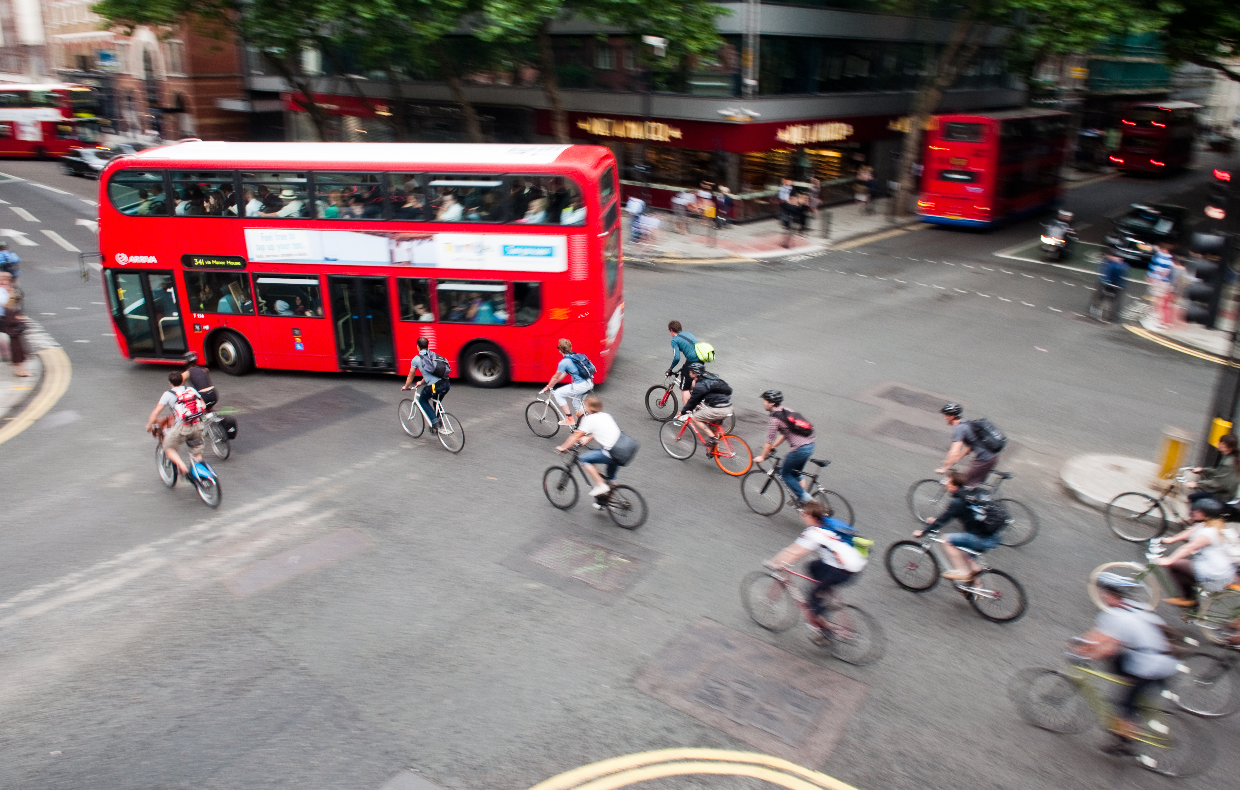London, England - July 5, 2011: Commuter cyclists set off from a green light at a busy road junction...