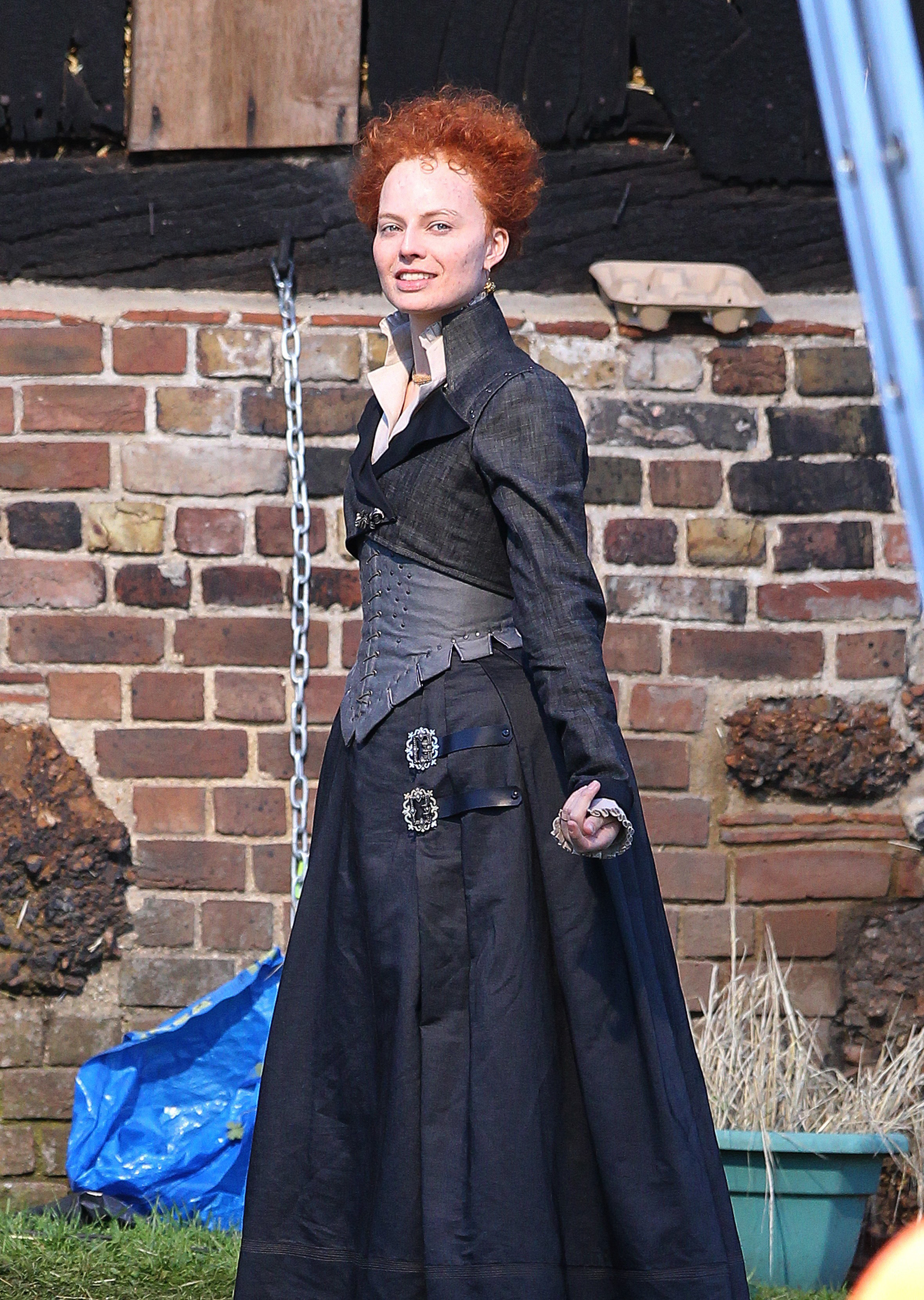 EXCLUSIVE: ***PREMIUM EXCLUSIVE RATES APPLY*** Margot Robbie looks completely unrecognisable as she transforms into Queen Elizabeth I for new film Mary Queen of Scots. The Australian star, 27, was the spitting image of The Virgin Queen as she donned traditional Tudor garb including a corset, jacket and wide buckled skirt to get into character for her new role. <P> Pictured: Margot Robbie <B>Ref: SPL1558320  210817   EXCLUSIVE</B><BR/> Picture by: Flynet - Splash News<BR/> </P><P> <B>Splash News and Pictures</B><BR/> Los Angeles:310-821-2666<BR/> New York:212-619-2666<BR/> London:870-934-2666<BR/> photodesk@splashnews.com<BR/> </P>