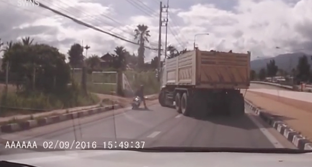 Moped rider crashes into 20-tonne truck - and survives