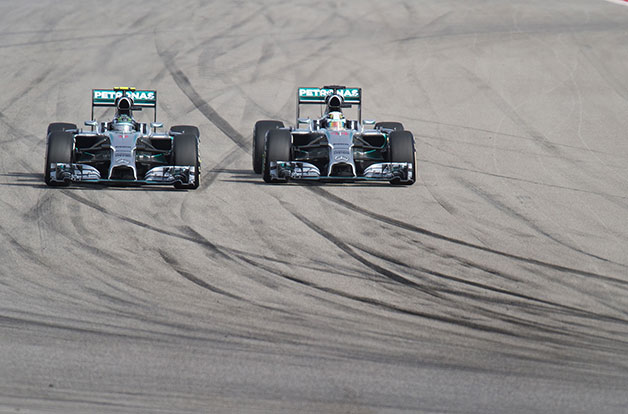 Lewis Hamilton passes Nico Rosberg for the lead at the 2014 US Grand Prix.