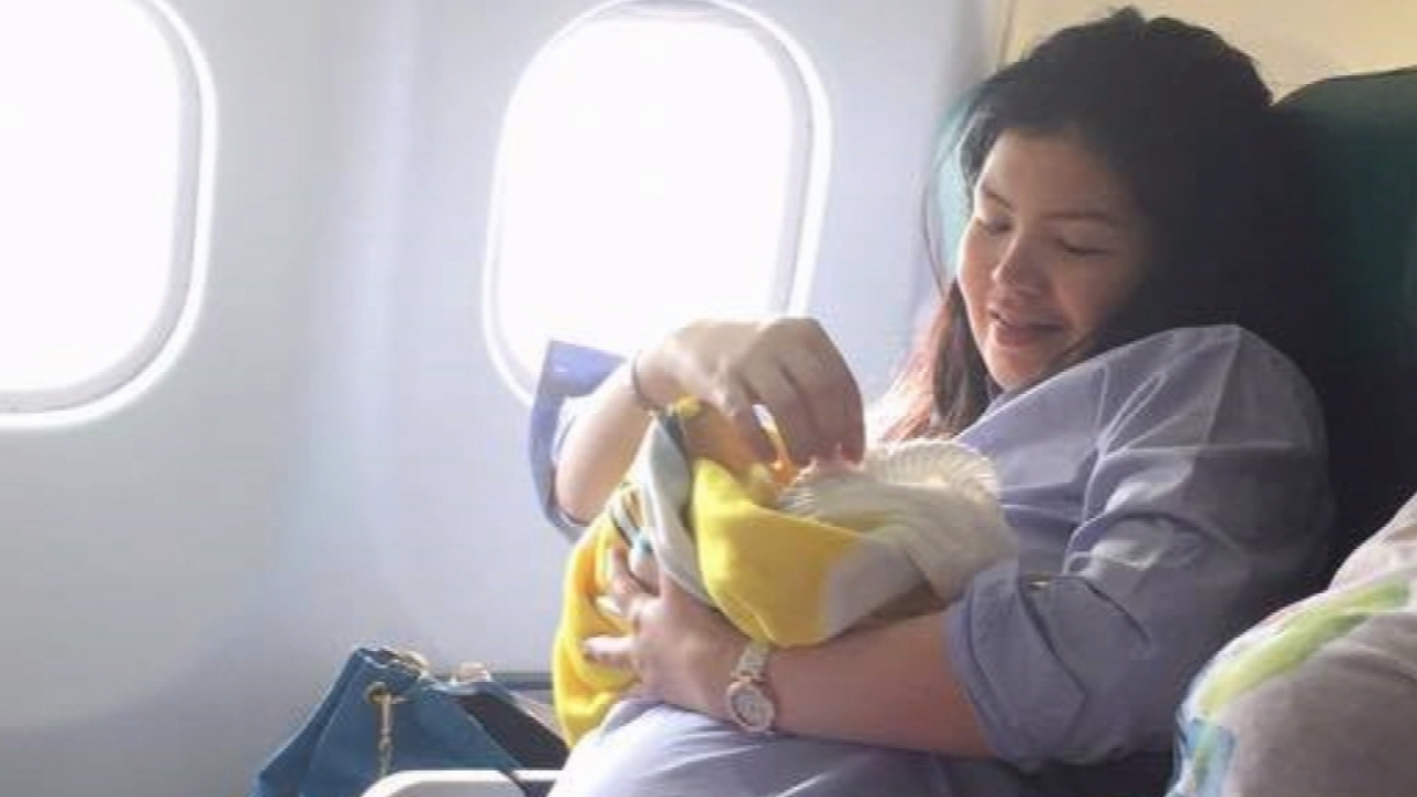 Baby born on plane gets the ultimate birthday gift