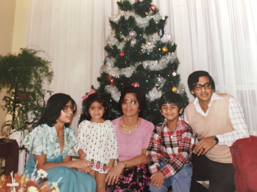 This was our first tree (that my folks still use)! My sister, Jennifer, left, is apparently skeptical...