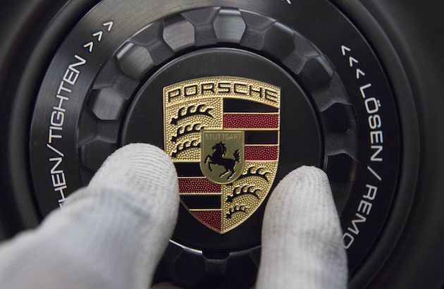 The logo of German luxury car producer Porsche is mounted on the wheel rim of a Porsche sportscar in the company's factory in Stuttgart, southwestern Germany, on January 26, 2018. / AFP PHOTO / THOMAS KIENZLE        (Photo credit should read THOMAS KIENZLE/AFP/Getty Images)
