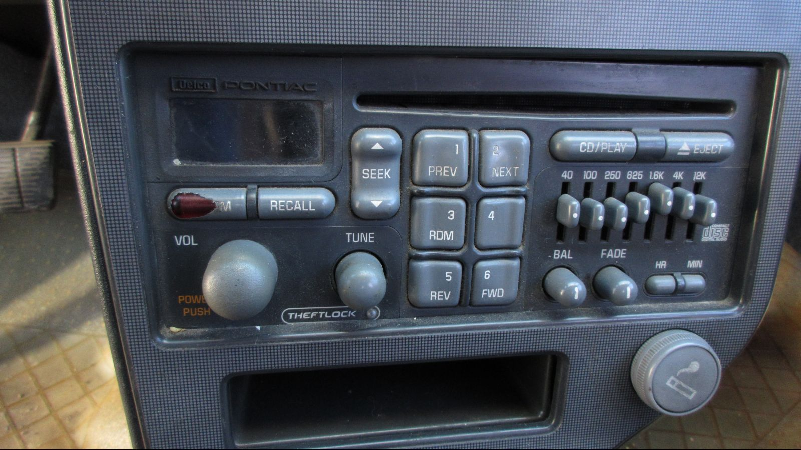 This 1991 Pontiac Grand Am With A 5 Speed Manual Is Junkyard Gem Engine Technology Here We See An Interesting Mix Of 1980s And 1990s Car Radio Cd Players In Cars Were Still Costly Luxury Items Seldom Seen Affordable