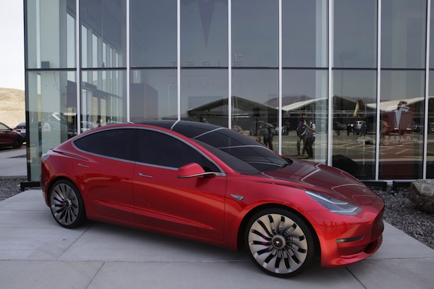 A Tesla Motor Inc. Model 3 vehicle is displayed outside the company's Gigafactory in Sparks, Neveada, U.S., on Tuesday, July 26, 2016. Tesla officially opened its Gigafactory on Tuesday, a little more than two years after construction began. The factory is about 14 percent complete but when it's finished, it will be about 10 million square feet, or about the size of 262 NFL football fields. Photographer: Troy Harvey/Bloomberg