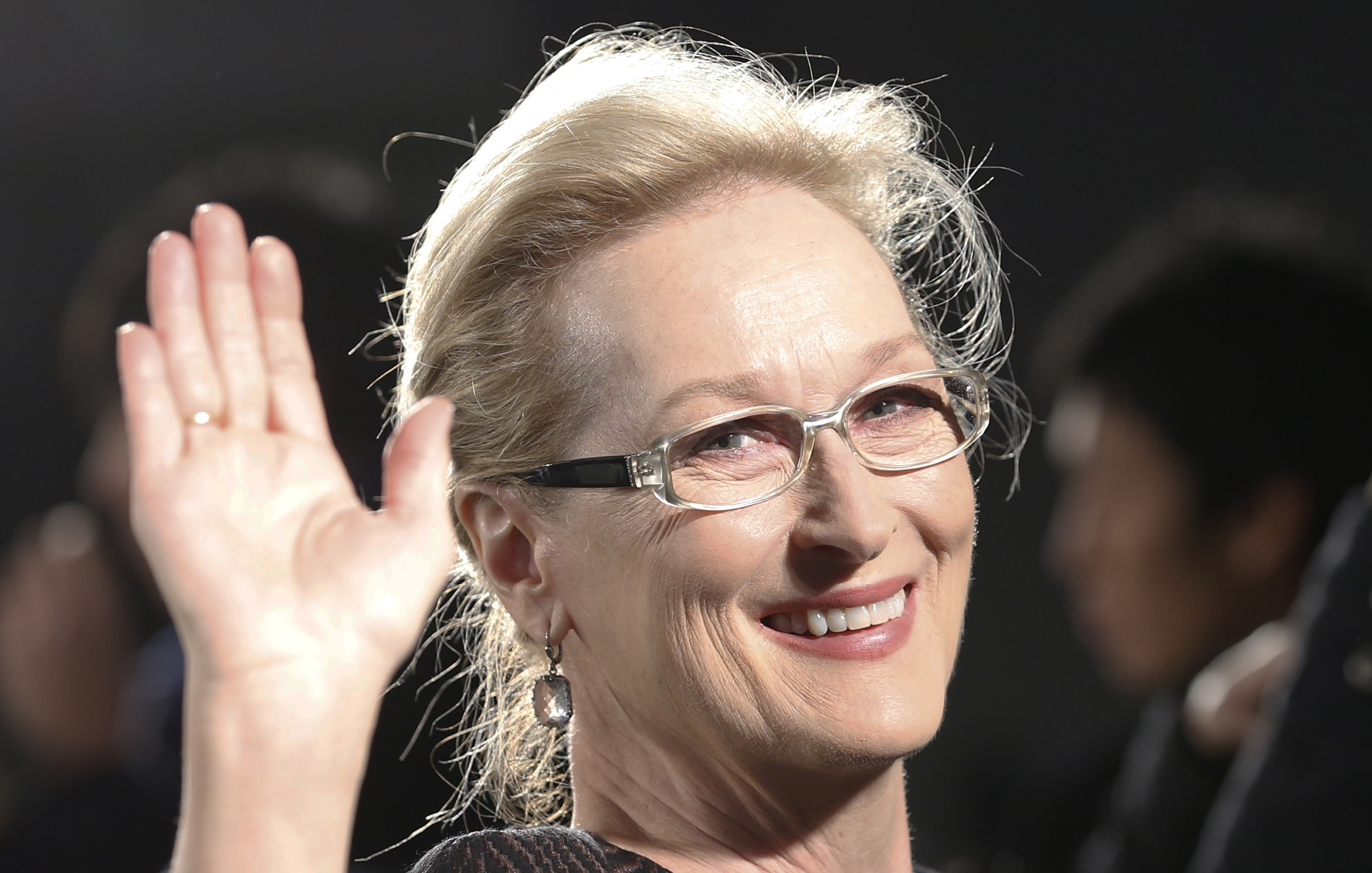 """Meryl Streep waves for photographers during the Japan premiere of """"Into the Woods"""" in Tokyo Wednesday, March 4, 2015. (AP Photo/Shizuo Kambayashi)"""