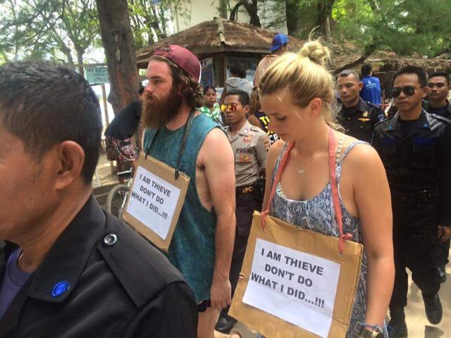 Australian tourist 'thieves' do walk of shame in Indonesia