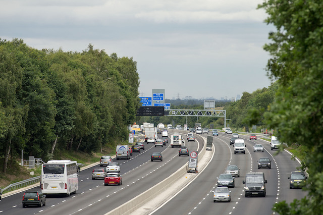"""Cars use the M3 """"smart"""" motorway near Longcross,  Surrey after it opened today. The 13.4-mile stretch between Farnborough and the M25 is now a four-lane carriageway after the main construction work was completed. Motorists have faced years of delays and disruption since work began in late 2014. PRESS ASSOCIATION Photo. Picture date: Monday July 3, 2017."""