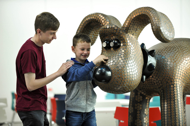 EDITORIAL USE ONLY Cameron Williams (left) and Rory Whyte during a visit to The Royal Mint Experience, which opens to the public today at The Royal Mint in South Wales. PRESS ASSOCIATION Photo. Issue date: Tuesday May 17, 2016. The Royal Mint Experience will give visitors first-hand knowledge of the manufacturing journey, while a series of static and interactive exhibitions consisting of six zones will bring the 1,000-year-old organisation�s rich heritage to life. Photo credit should read: Alistair Heap/PA Wire