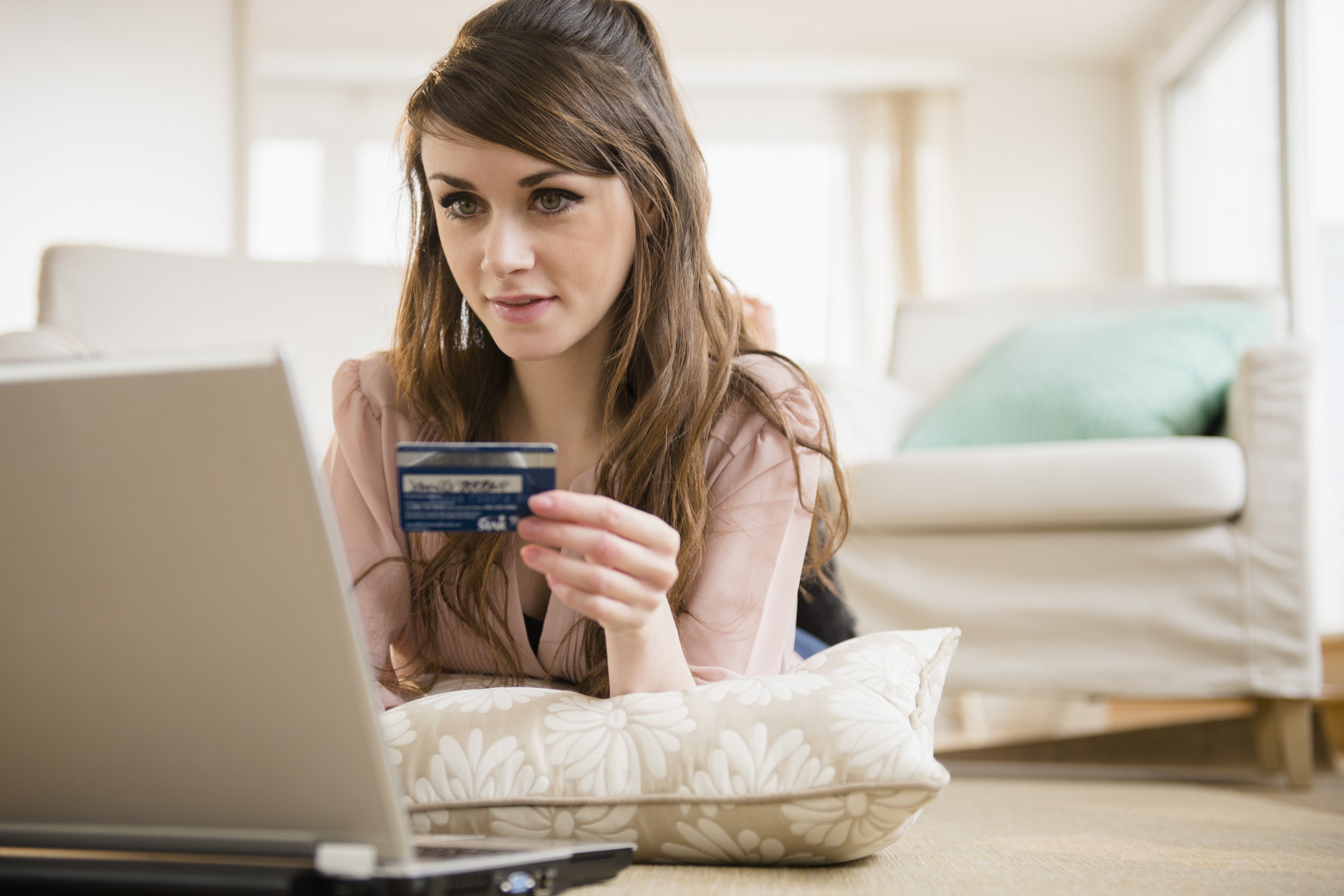 USA, New Jersey, Jersey City, Young woman shopping online with credit card