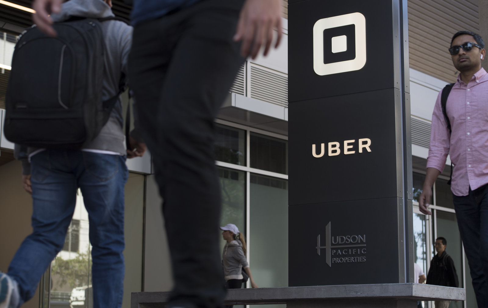 Pedestrians walk past the Uber Technologies Inc. headquarters building in San Francisco, California, U.S., on Wednesday, June 21, 2017. Travis Kalanick has resigned from his job leading Uber Technologies Inc., giving up his effort to hold onto power as a torrent of self-inflicted scandals enveloped him and the global ride-hailing leviathan he co-founded. Photographer: David Paul Morris/Bloomberg via Getty Images