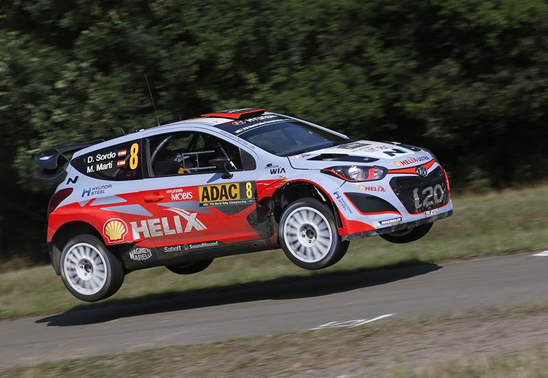 The Hyundai i20 WRC of Dani Sordo flying at the 2015 ADAC Rallye Deutschland.