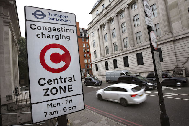 File photo dated 08/08/14 of a congestion charge sign in London. Foreign embassies and international organisations have racked up debts on unpaid congestion charge totalling more than £100 million since the levy's introduction in London in 2003, Boris Johnson has disclosed.