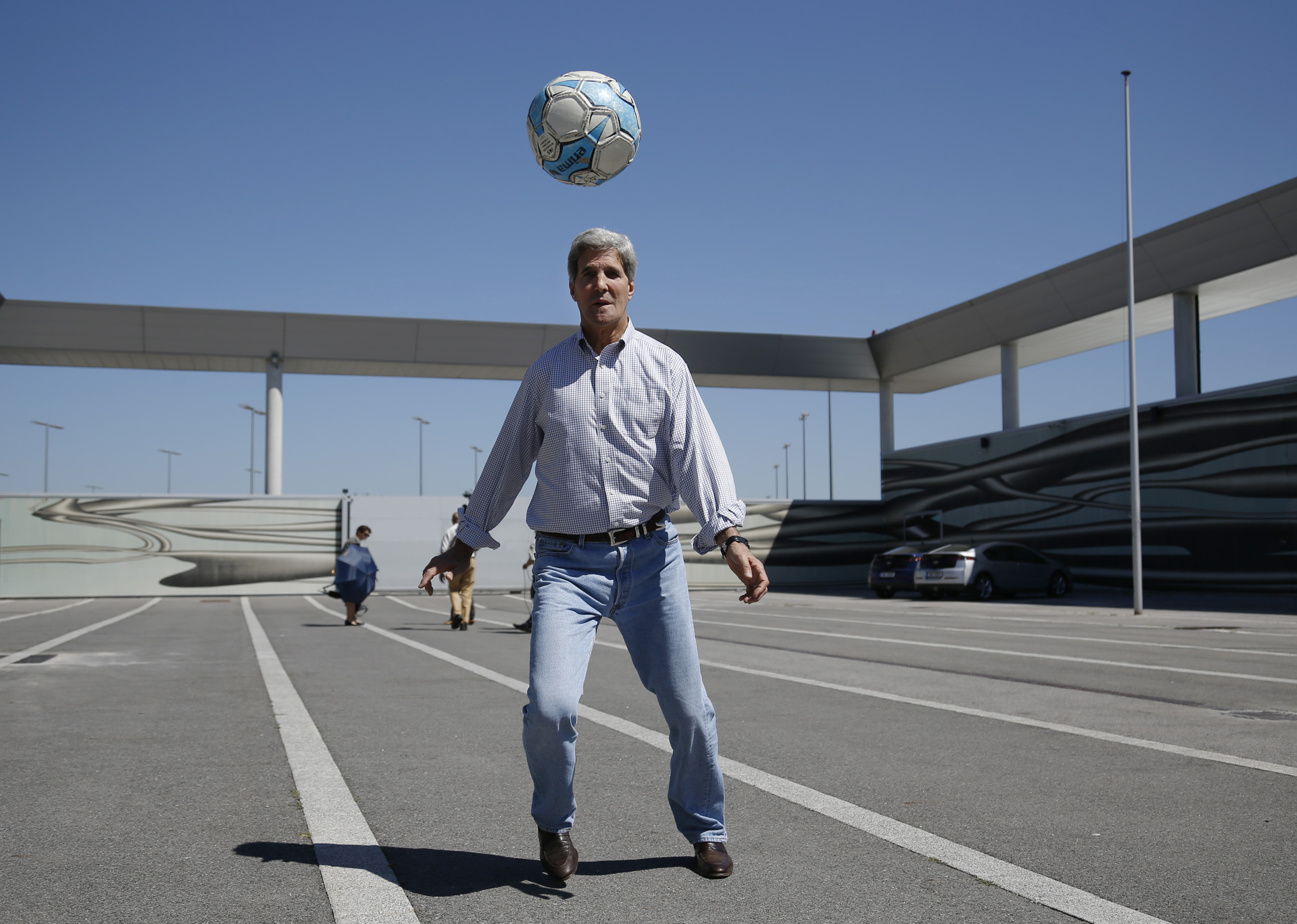 John Kerry playing with a soccer ball