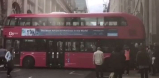 Double-decker bus gets wedged in London street