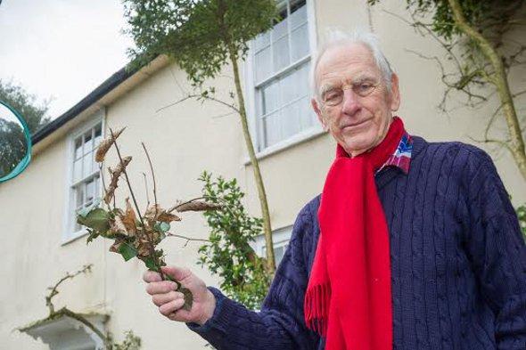 Mr Tolhurst outside his home.