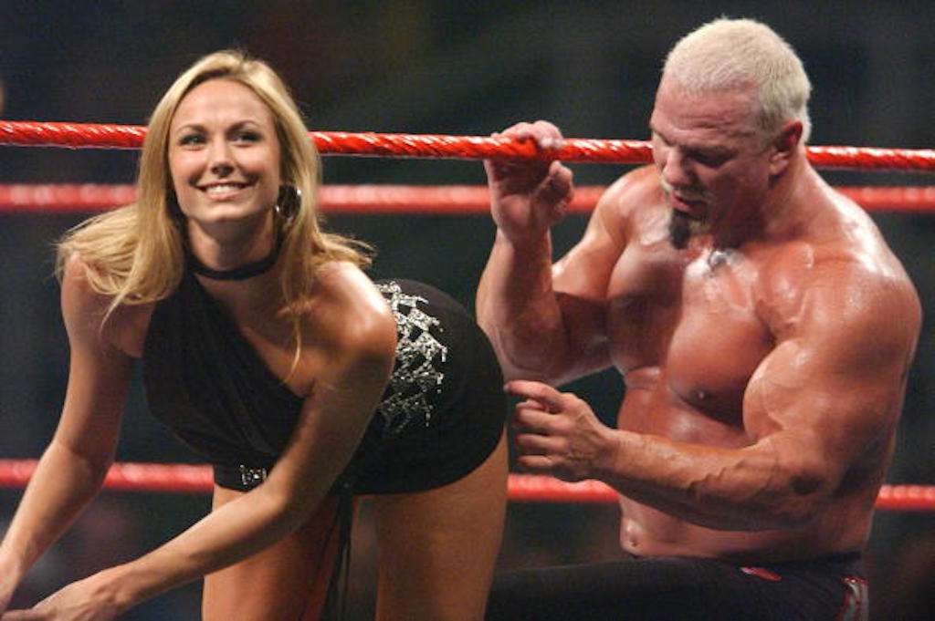 MELBOURNE, AUSTRALIA - JULY 31:  Stacy Keibler is helped out of the ring by Big Pappa Pump during the WWE Raw Aggression Tour event at Rod Laver Arena, Melbourne Park July 31, 2003 in Melbourne, Australia. (Photo by Ryan Pierse/Getty Images)