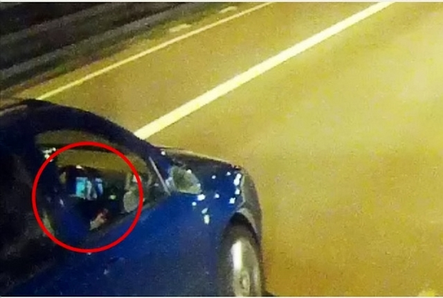 M5 driver allegedly watching movie at wheel
