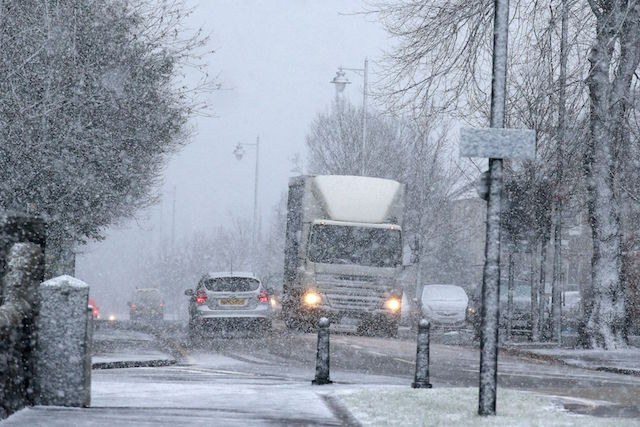 Vehicles driving down Dumbarton Road in Stirling during a snow blizzard, as a cold weather front is to sweep in with temperatures expected to drop as much as 10C to below zero overnight into Thursday.