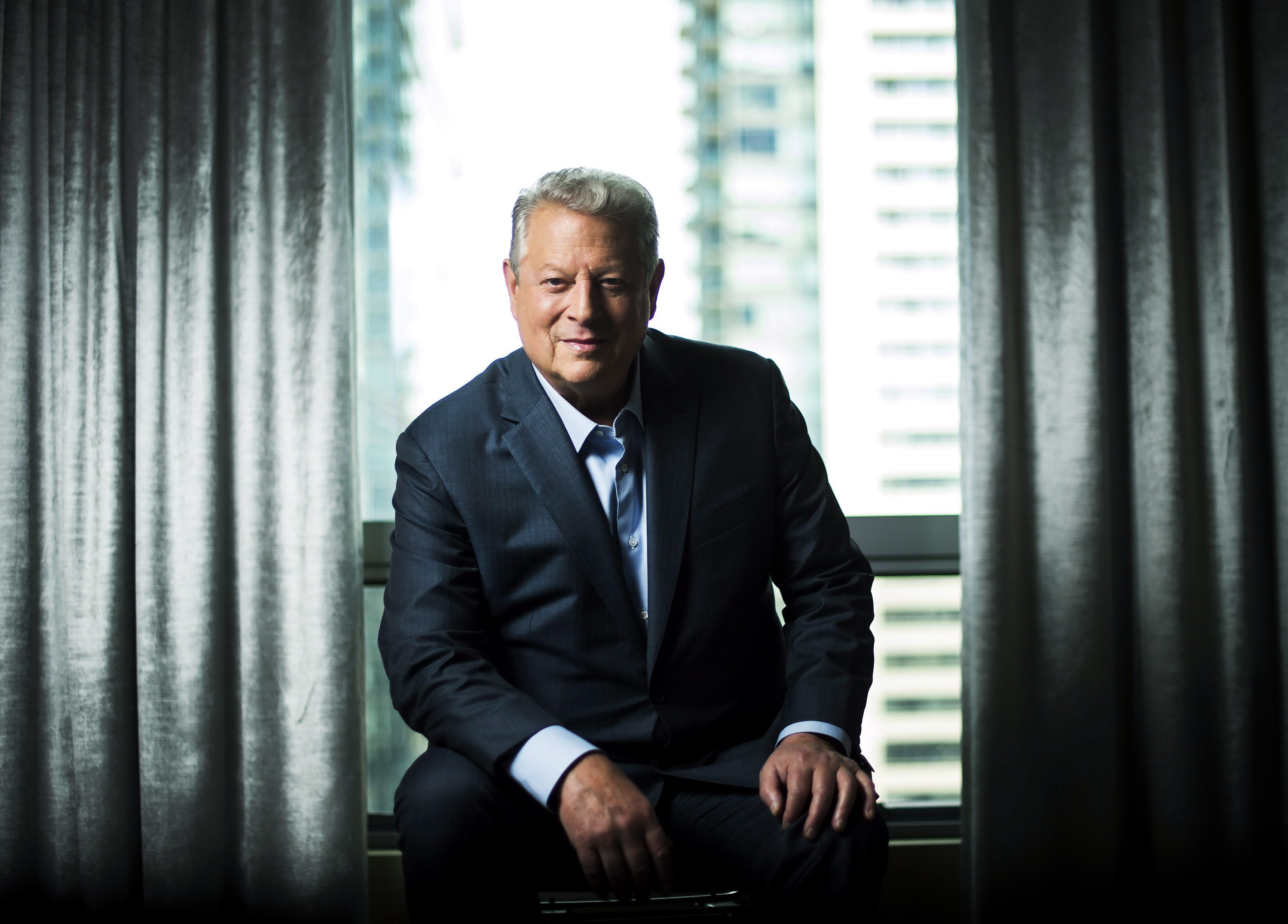 "Al Gore poses for a photograph before talking about his new film ""An Inconvenient Sequel: Truth..."