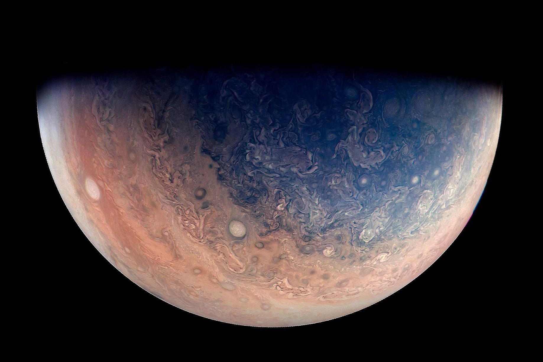 This enhanced color view of Jupiter's south pole was created using data from the JunoCam instrument on NASA's Juno spacecraft. Oval storms dot the cloudscape.