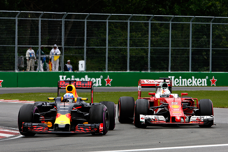 Daniel Ricciardo of Australia driving the (3) Red Bull Racing Red Bull-TAG Heuer RB12 TAG Heuer battles with Sebastian Vettel of Germany driving the (5) Scuderia Ferrari SF16-H Ferrari 059/5 turbo (Shell GP) on track during the Canadian Formula One Grand Prix at Circuit Gilles Villeneuve on June 12, 2016 in Montreal, Canada.