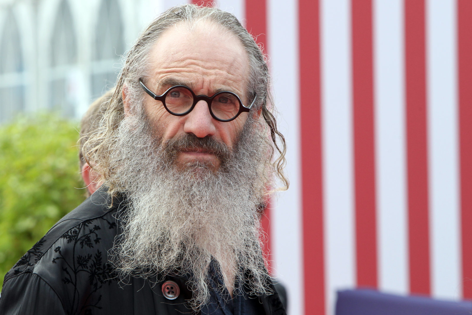"British director, Tony Kaye arrives for the screening of his latest movie ""Detachment"", during the 37th American Film Festival, in Deauville, northwestern France, on September 9, 2011. The event runs until September 11.   AFP PHOTO / KENZO TRIBOUILLARD (Photo credit should read KENZO TRIBOUILLARD/AFP/Getty Images)"