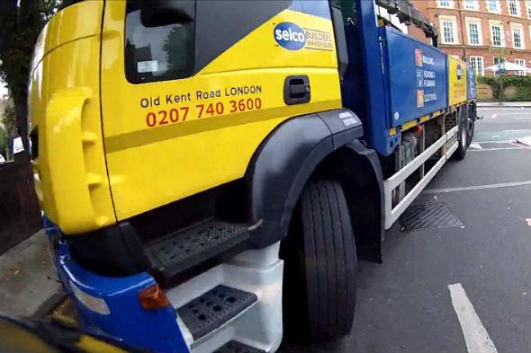 Lorry knocks biker off