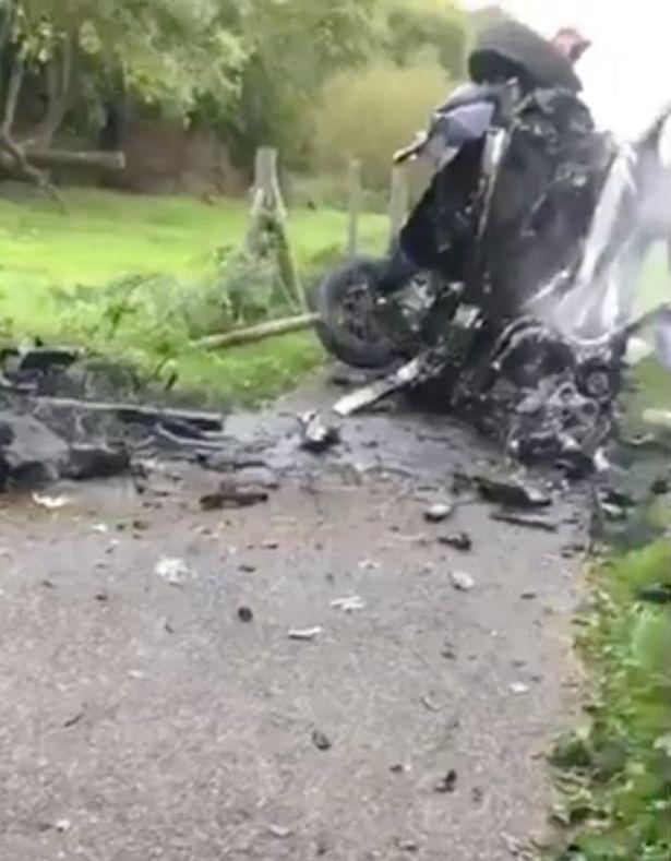 Car plunges 30ft off motorway bridge