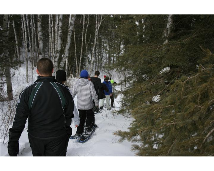 Group of volunteers tracking through the snow (Photo by Josh