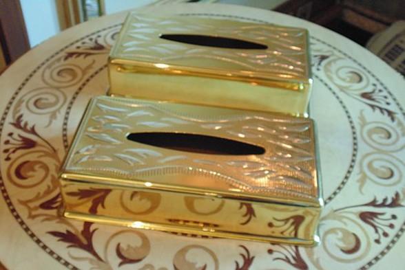 A gold tissue box