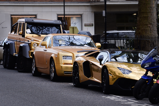 Three gold cars from Saudi Arabia (left-right) a 6x6 Mercedes G 63, Rolls-Royce Phantom Coupe and Lamborghini Aventador have received parking tickets on Cadogan Place in Knightsbridge, London.