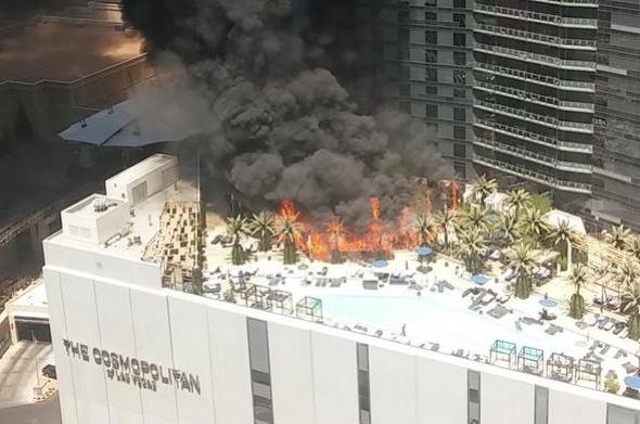 Huge fire rips through Las Vegas hotel rooftop pool