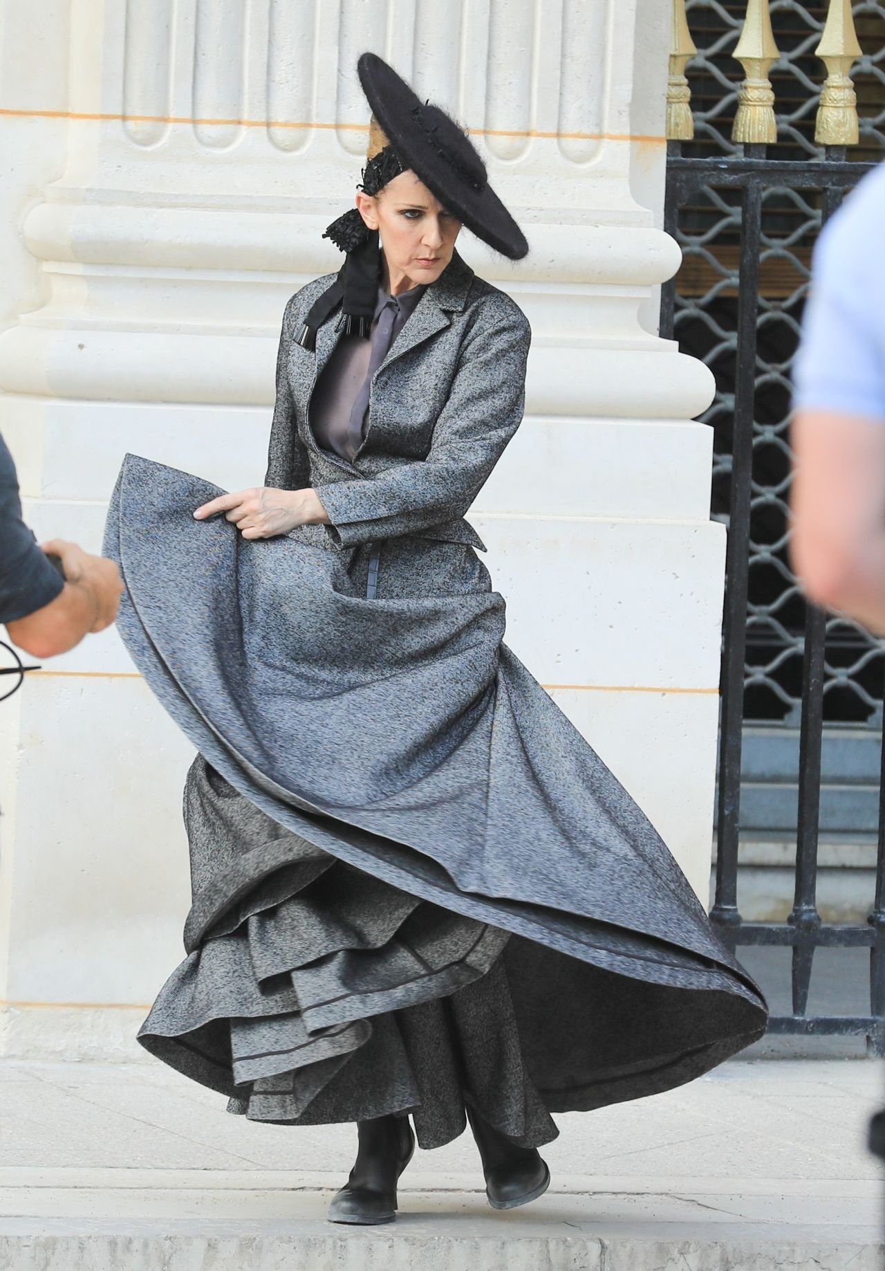 ** RIGHTS: ONLY UNITED STATES, CANADA ** Paris, FRANCE  - Singer Celine Dion is spotted dancing during a video shoot for Vogue in the garden of the Palais Royal in Paris, France. Celine was wearing a turn of the century grey dress with a wide brim black hat.  Pictured: Celine Dion  BACKGRID USA 6 JULY 2017   BYLINE MUST READ: Best Image / BACKGRID  USA: +1 310 798 9111 / usasales@backgrid.com  UK: +44 208 344 2007 / uksales@backgrid.com  *UK Clients - Pictures Containing Children Please Pixelate Face Prior To Publication*