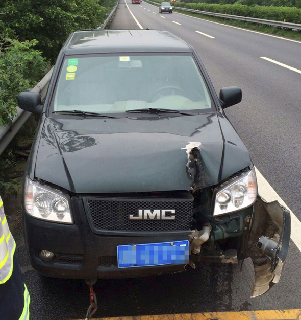 Mandatory Credit: Photo by Imaginechina/REX Shutterstock (4850359c) The car with the damage caused by the circular saw blade Circular saw blade slices into car after falling off truck, Chongqing, China - 17 Jun 2015 A man in western China had a close shave after his car was hit by a massive circular saw blade while he was driving along the road. The motorist was driving to Chongqing when he heard a bang come from the opposite lane before spotting a huge circular bouncing through the bushes of the central reservation. The blade then smashed into the front of his vehicle, slicing around 50cm into the bonnet. Highway police said another truck had crashed in the opposite lane and the blade had been thrown off the vehicle and into the road.