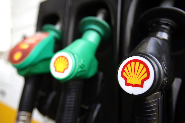 File photo dated 08/04/15 of Shell logos on petrol pumps at a petrol station. Royal Dutch Shell has reported a large rise in second quarter profits after the energy giant was boosted by higher oil and gas prices.