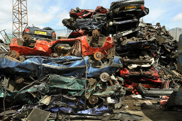 A pile of crushed cars piled high in a breaker's yard in Neasden north west London, where Metropolitan Police officers checked cars in a breaker's yard in Harrow, North West London, after a rise in older cars being stolen and crushed for their scrap metal value and then being shipped overseas.