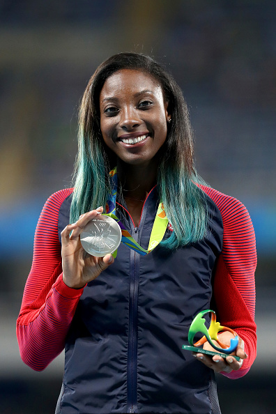 Nia Ali of the U.S. poses on the podium during the medal ceremony for the women's 100-metre hurdles at...