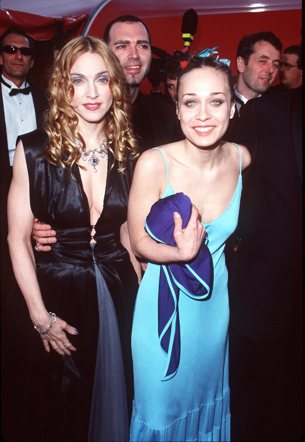 Madonna and Fiona Apple during The 70th Annual Academy Awards - Red Carpet at Shrine Auditorium in Los...